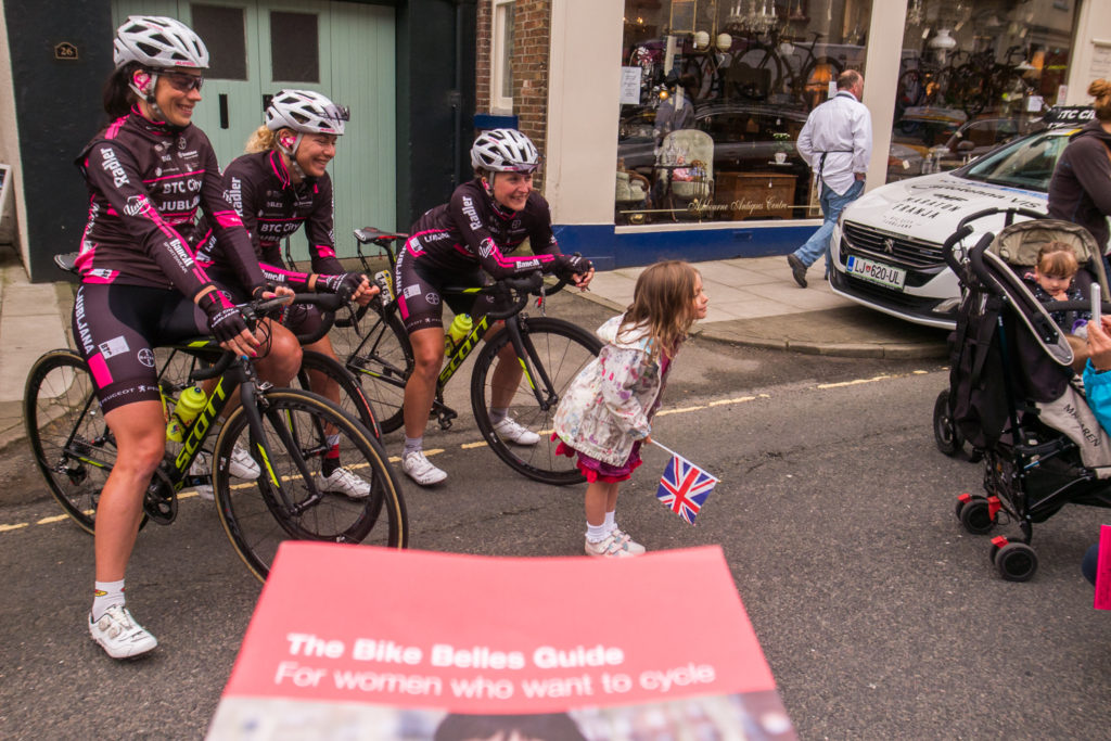 Women of Slovenian cycling team BTC City Ljubljana have their picture taken with young English fan. PHOTO MARK KOGHEE
