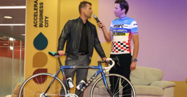 Mark Koghee, creator of the exposition, interviews former cyclist Andrej Hauptman, who lent his bike to the exposition.